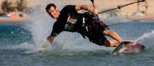 Water sports instructor kitesurfing at Lifetime Sports